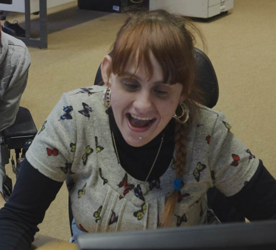 Rachel and Holly laughing at work
